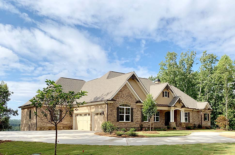 Craftsman, Ranch, Tudor House Plan 52021 with 4 Beds, 5 Baths, 3 Car Garage Picture 2